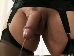 Tranny dominatrix is drilling his hairy ass, gives a mouthful and she pees