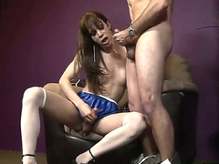 A brunette shemale slides her huge cock into the ass of his boyfriend as he masturbates