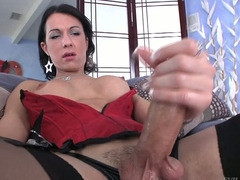 Shemale brunette Danika Dreamz in red corset and black stockings gets her hard dick out to masturbate in front of you. She polishes his rod with big enthusiasm
