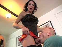 Dark haired shemale Danika Dreamz in black stockings and red mini skirt gets her blood filled hard dick sucked by hot curious guy Christian A. They both love the fun