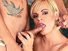 Pig-tailed blonde tranny Thays Schiavinato joins her man as he suns himself poolside. He helps her off with her panties and bends her over to lick and finger her tight asshole, and she sits to suck his hard cock. He does the same, sucking her dick while her jerks himself off. She gets on her hands..