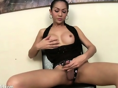 Glamorous shemale dressed in black teases her nipples and cock